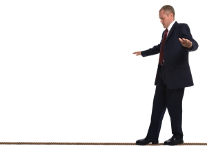 Businessman walking a tightrope